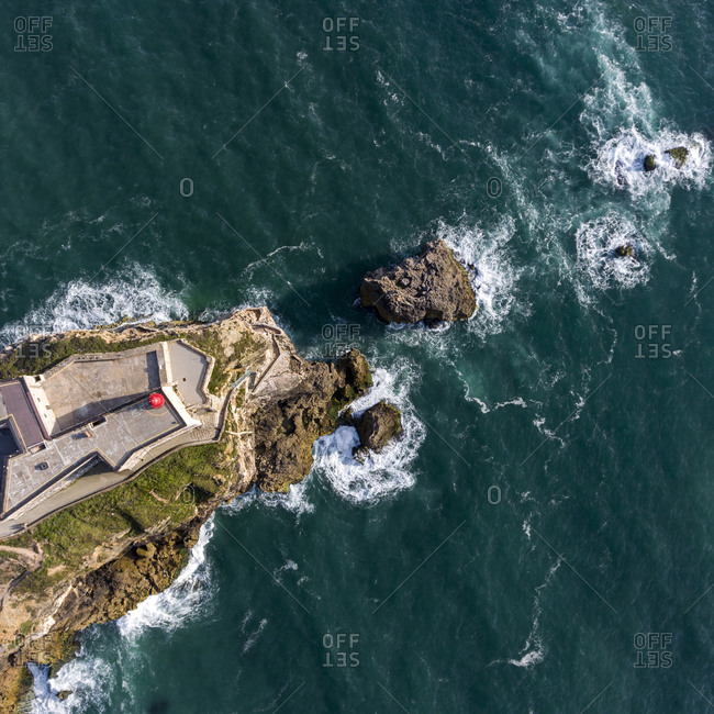 Lighthouse on the coast the Atlantic Ocean from above
