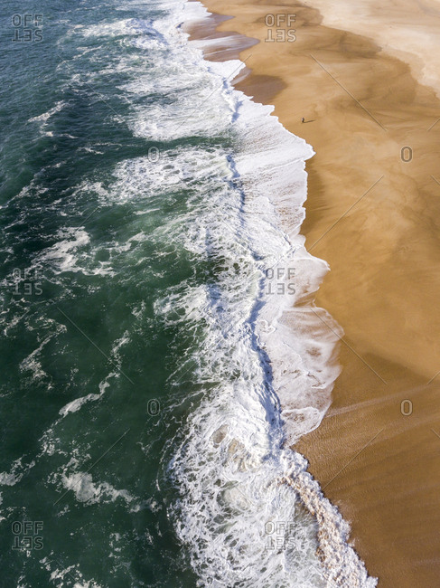 Waves in the Atlantic Ocean washing up on a beach