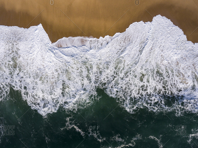 Overhead  view of waves of the Atlantic Ocean washing up on the shore