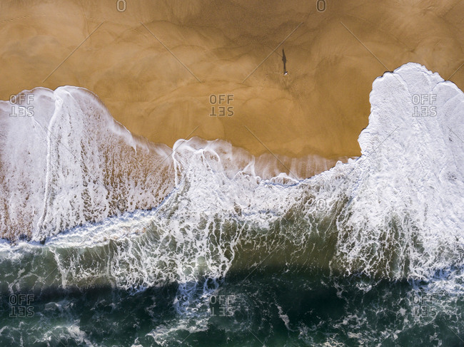 Waves of the Atlantic Ocean washing up on a sandy beach