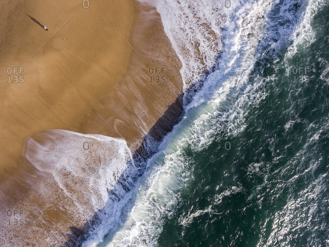 Waves in the Atlantic Ocean washing up on a sandy beach
