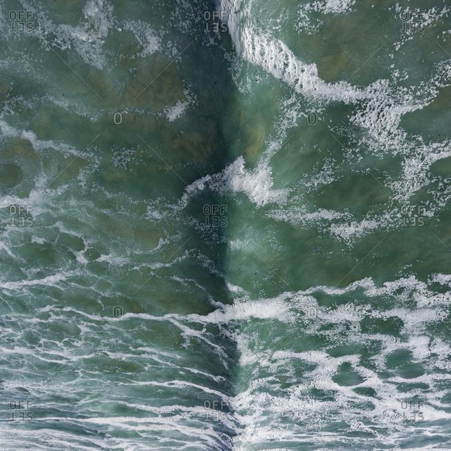 Bird's eye view of foamy water in the ocean