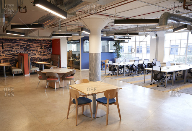 Kitchen, eating area and open plan desk workspace in a creative office