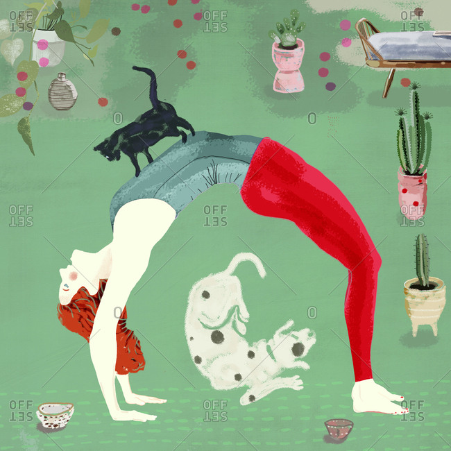 Woman practices yoga with her pets