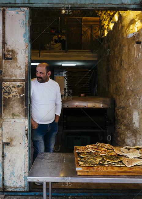 January 13, 2019: Arab pizza with za'atar at Shawar's Bakery in the old city, Jerusalem, Israel.