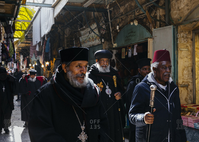January 21, 2019: A group of Ethiopian priests walking in a street in the old city, Jerusalem, Israel.