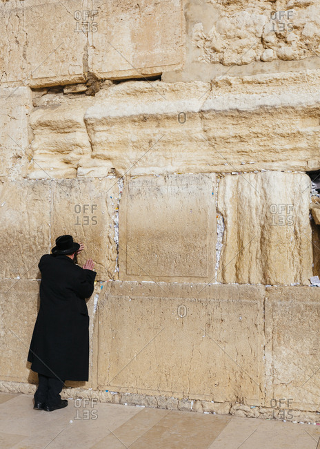 Orthodox Jewish man praying at the wailing wall known also as the western wall in the old city, Jerusalem, Israel.