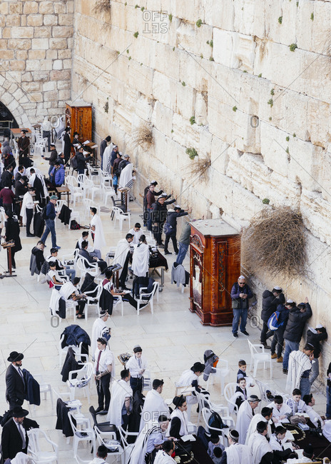 January 21, 2019: Jewish men praying at the wailing wall known also as the western wall in the old city, Jerusalem, Israel.