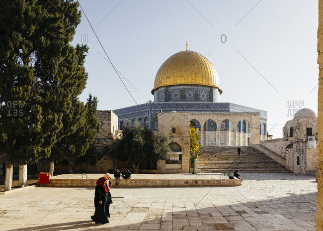 January 21, 2019: People walking near  the Dome of the Rock mosque, in the Temple Mount at the old city, Jerusalem, Israel.
