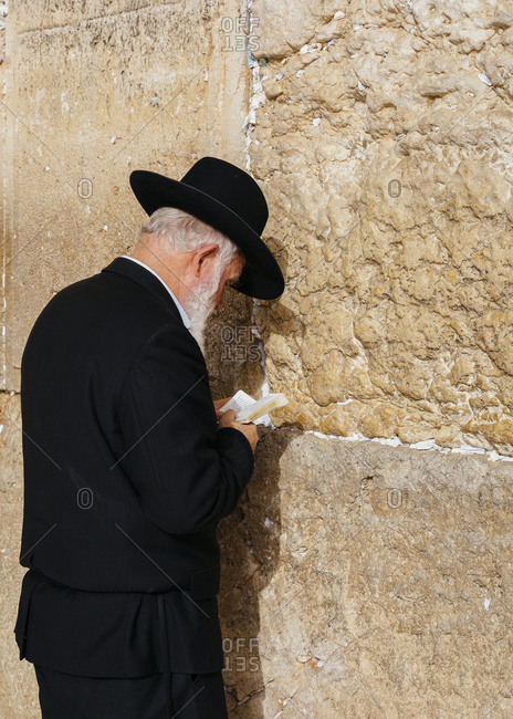 January 13, 2019: Orthodox Jewish man praying at the wailing wall known also as the western wall in the old city, Jerusalem, Israel.