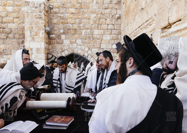 January 21, 2019: Orthodox Jewish men praying at the wailing wall known also as the western wall in the old city, Jerusalem, Israel.