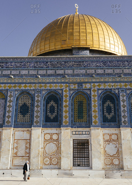 January 21, 2019: Woman walking near Dome of the Rock mosque, in the Temple Mount at the old city, Jerusalem, Israel.
