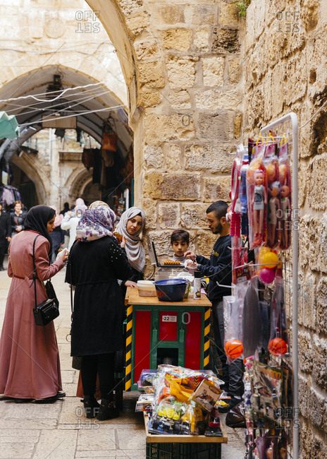 January 21, 2019: Women ordering food from a vendor in the old city, Jerusalem, Israel.