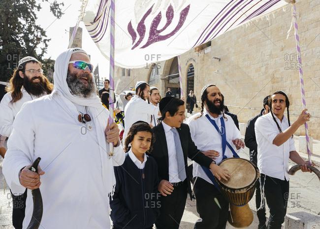 January 21, 2019: Orthodox Jewish people celebrating a Bar Mitzvah in the old city, Jerusalem, Israel.