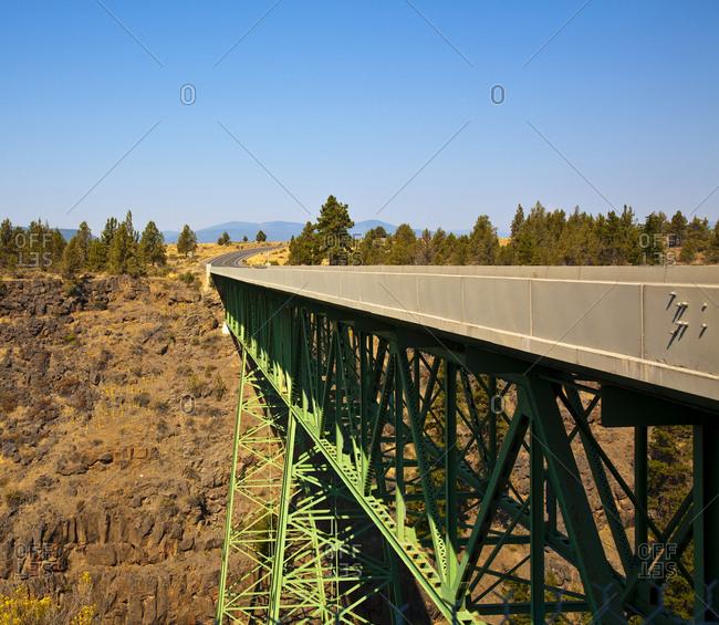 Truss Bridge and Rocky Cliff Face,Oregon, USA