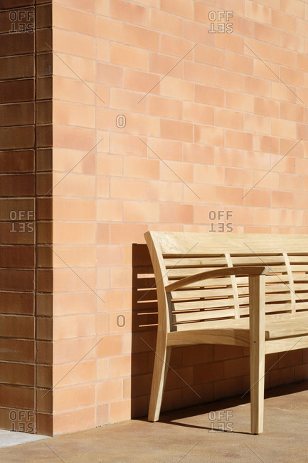 Wooden Bench Against Corner of Brick Building,Fort Worth, Texas, USA