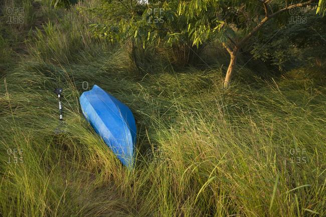 Abandoned Blue Canoe