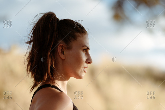 Profile view of young woman in workout clothes
