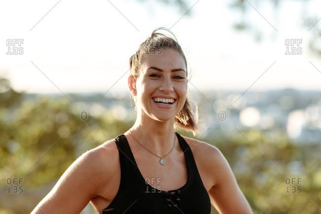 Happy young woman in workout clothes