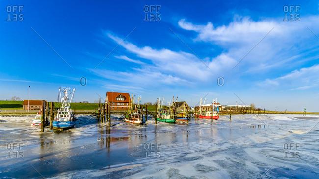 January 9, 2018: Germany- Lower Saxony- Butjadingen- Fedderwardersiel- harbor- fishing boats in winter