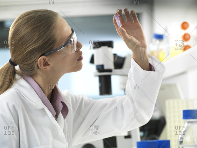 Scientist preparing a sample in a vial ready for analysis in the laboratory