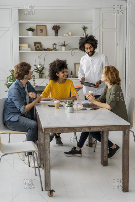 Young creative professionals working together in a coworking space