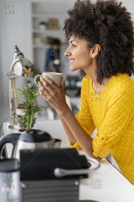 Woman enjoying her coffee break in the office
