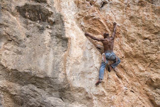 Greece- Kalymnos- climber in rock wall