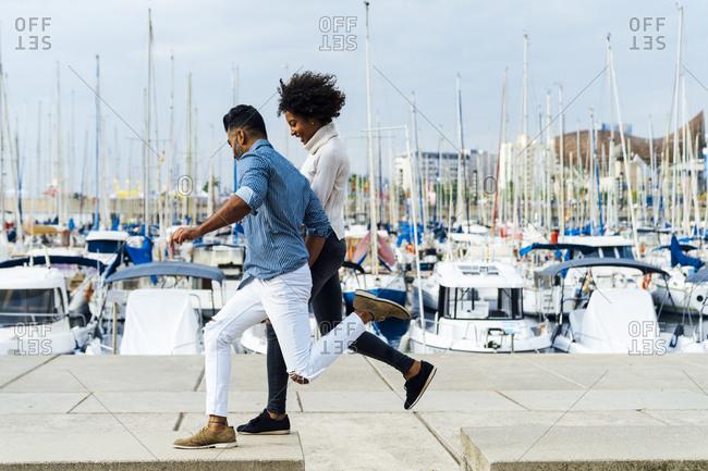 Spain- Barcelona- happy couple having fun at the marina