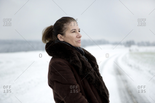 Portrait of mature woman in winter