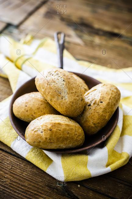 Rye bread rolls in pan