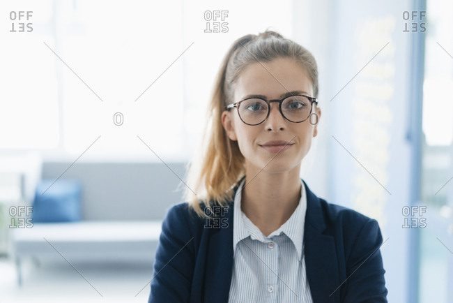 Portrait of a confident young businesswoman- standing in office