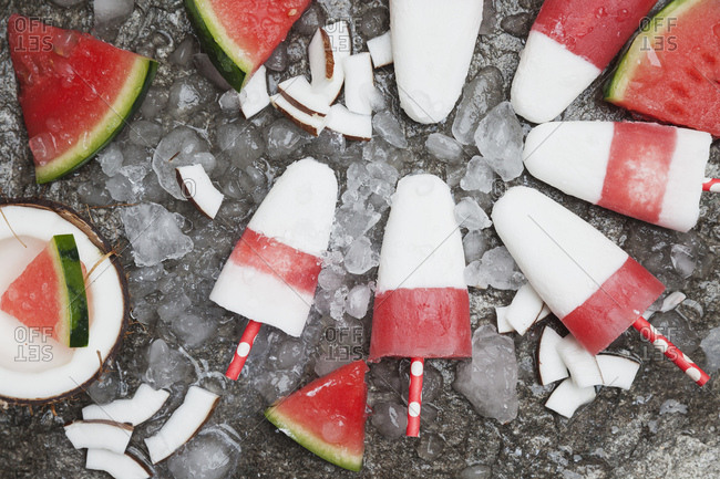 Homemade watermelon coconut ice lollies on crushed ice