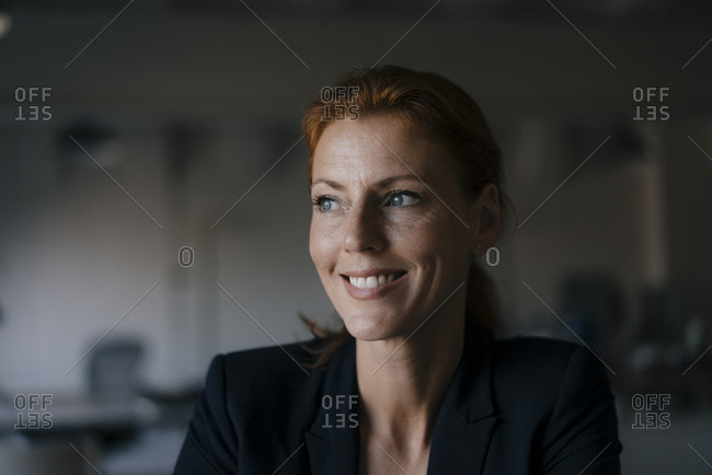 Portrait of smiling businesswoman looking sideways