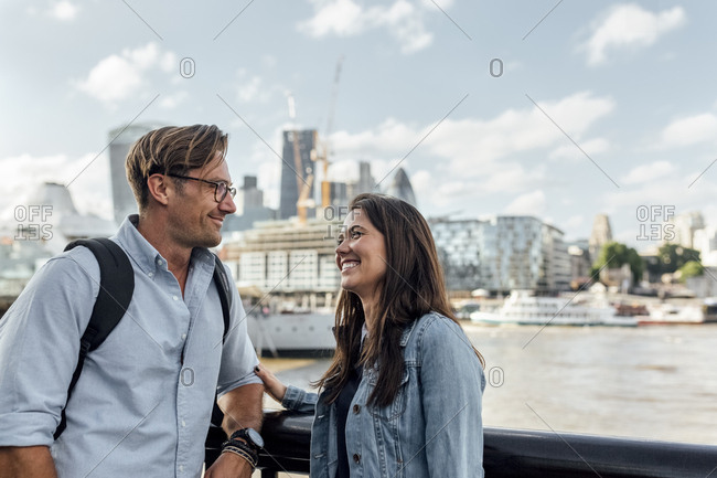 UK- London- smiling couple with skyline in the background