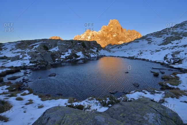 Italy- Trentino- Dolomites- Passo Rolle- Pale di San Martino range- mountain peak Cimon della Pala in the evening light