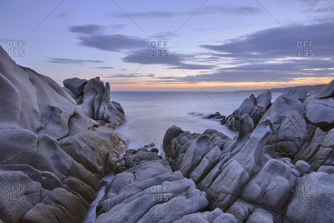 Italy- Sardinia- Granite rocks on coast at sunrise at Capo Testa