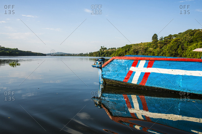 Africa- Uganda- Jinja- Colorful boat at the source of the Nile