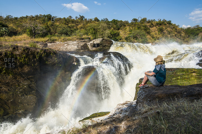 Africa- Uganda- Woman looks at the stunning Murchison Falls- on the Nile- Murchison Falls National Park
