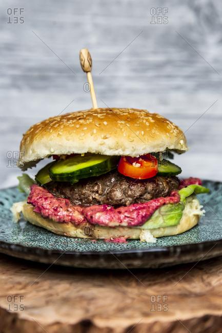 Hamburger with beetroot hummus- cucumber- tomato and salad