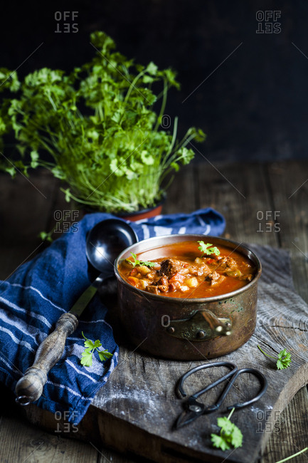 Goulash soup with flat leaf parsley