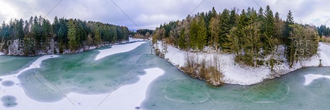 Germany- Baden-Wuerttemberg- Ostalbkreis- Swabian forest- Aerial view of forest and Eisenbach reservoir in winter