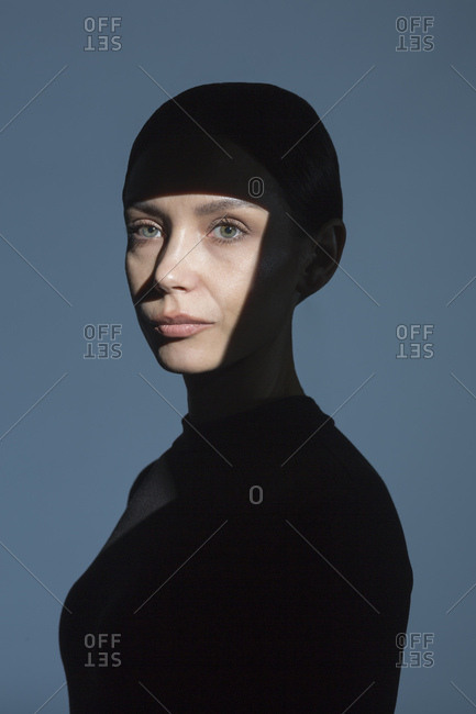 Portrait of woman with shadow and light on her face