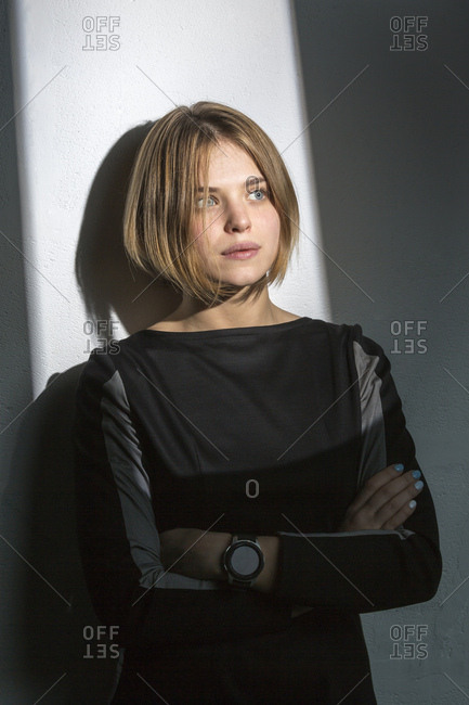 Portrait of pensive blond young woman with bob hairdo