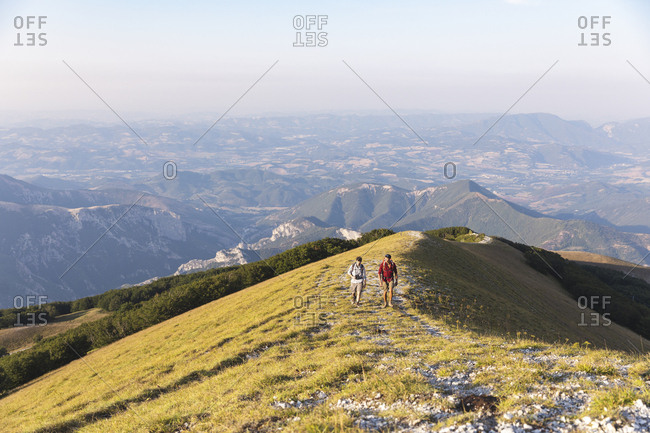 Italy- Monte Nerone- two men hiking on top of a mountain in summer