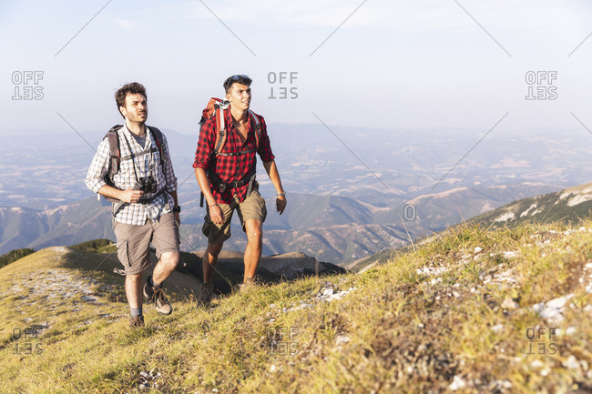 Italy- Monte Nerone- two men hiking in mountains in summer