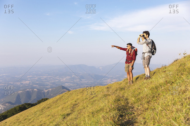 Italy- Monte Nerone- two hikers in the mountains enjoying the view