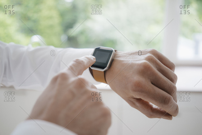 Man pointing at his smart watch