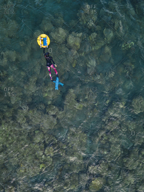 Free divers with buoy in ocean