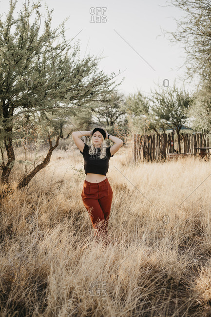 Africa- Namibia- blonde woman standing in grassland
